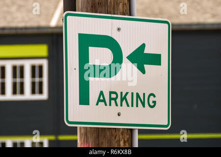 SEATTLE, WA, USA - JUNE 2018: Close up of a sign on a city centre street in Seattle informing drivers of parking facilities. - Stock Photo