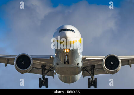 LONDON, ENGLAND - NOVEMBER 2018: Head on view of a Jet Airways Boeing 777 airliner about to land at London Heathrow Airport. - Stock Photo