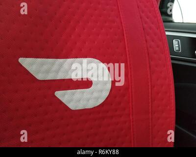 Insulated delivery bag with logo for food delivery gig economy app Doordash, in the front seat of a Doordash delivery vehicle in Walnut Creek, California, October 9, 2018. () - Stock Photo