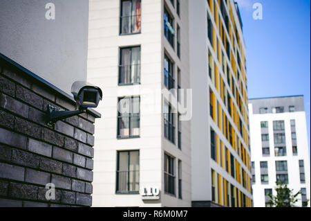 outdoor CCTV camera external video surveillance system. installed on the facade of a residential building - Stock Photo