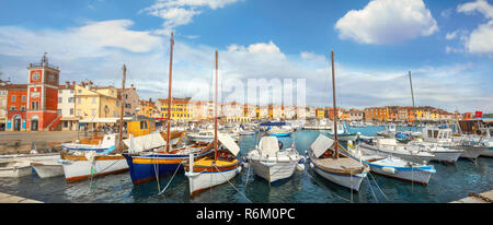 Panoramic view of seafront with bell tower and marina in harbour at old town Rovinj. Istria, Croatia - Stock Photo