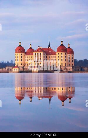 Moritzburg castle after sunrise at winter time, Germany - Stock Photo