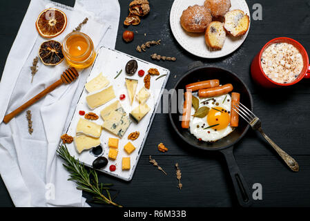 fried egg with sausages and cheese board - Stock Photo