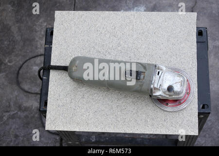 Flat lay view of disc cutter power tool used for cutting hard materials as ceramic tile. - Stock Photo