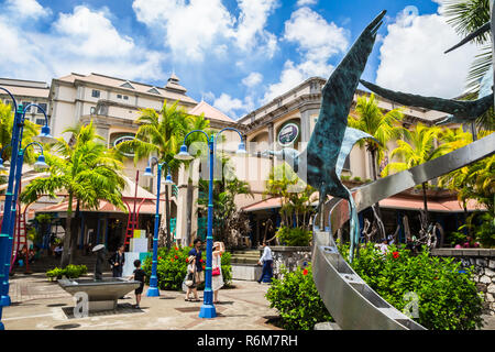Port Louis, Mauritius - February 12, 2018 - Caudan Waterfront, main shopping district of the capital city - Stock Photo
