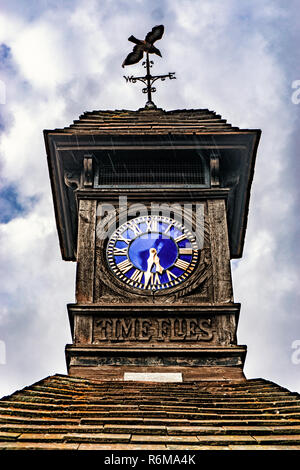 Time Flies, Very old Clock, outdoors on a rainy day - Stock Photo