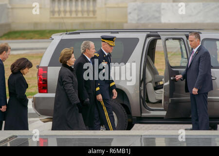 Former President George W. Bush, 43rd President of the United States and his wife former First Lady Laura Bush, are escorted to the bottom of the steps of the United States Capitol before the transfer of the casket of George H.W. Bush, 41st President of the United States, from the United States Capitol to the Washington National Cathedral, Washington, D.C., Dec. 5, 2018. Nearly 4,000 military and civilian personnel from across all branches of the U.S. armed forces, including Reserve and National Guard Components, provided ceremonial support during George H.W. Bush's, the 41st President of the  - Stock Photo