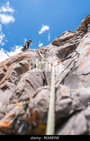 The last movements to reach the summit by a male climber. Rock climbing inside Andes mountains and valleys at Cajon del Maipo, an amazing place