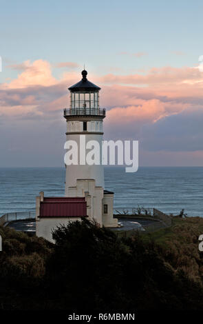 WA15414-00...WASHINGTON - North Head Light located on a bluff overlooking the Pacific Ocean in Cape Disappointment State Park at sunrise. - Stock Photo