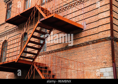 Fire escape stairs and old brick building in Khabarovsk, Russia - Stock Photo