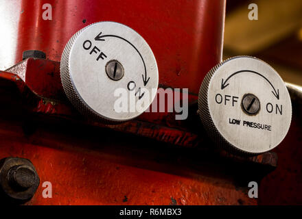 Vintage antique automotive machine shop hydraulic press pressure valve dials - Stock Photo