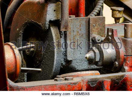 Vintage antique automotive machine shop dirty piston grinding machine - Stock Photo