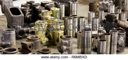 Vintage antique automotive machine shop stainless steel sleeved hydraulic cylinders and tubing - Stock Photo
