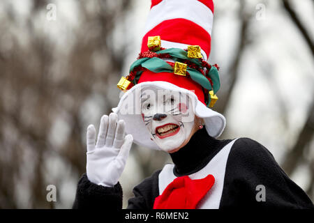 Prescott, Arizona, USA - December 1, 2018: Woman wearing a Cat in the Hat costume and waving while participating in the Christmas parade in downtown P - Stock Photo