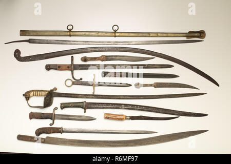 Armoury display of historic swords and daggers - Stock Photo
