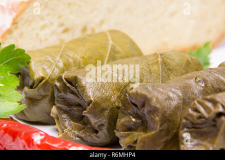 Grape leaves rolls. Sarmale, dolma, dolmades, sarma, golubtsy or golabki. - Stock Photo