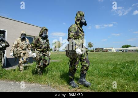 Members of the British Armed Forces assigned to local units, exit the U.S. Army Training Support Center Benelux Chemical, Biological, Radiological and Nuclear facility on Chièvres Air Base, Belgium, May 09, 2017. - Stock Photo