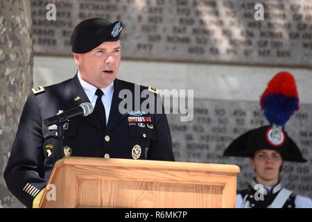 U.S. Army Europe Commanding General Lt. Gen. Ben Hodges speaks during the Memorial Day Ceremony at the Florence American Cemetery and Memorial, Florence, Italy, May 29, 2017. - Stock Photo