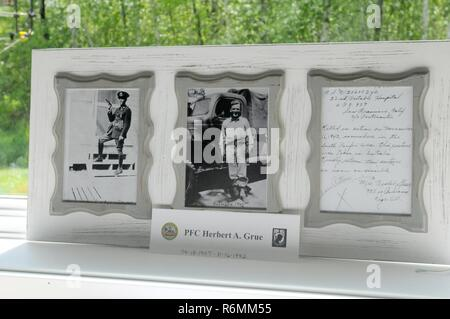 Photos of Pfc. Herbert A. Grue along with a hand-written note sent to the family announcing his death in 1942 are on display at the home of his granddaughter Laura Ekstrom in Birchwood, Wisconsin. Ekstrom and her family were presented with the six awards earned by Grue who was killed while serving in the Pacific with the 22nd Portable Hospital unit. - Stock Photo