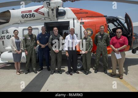 Congressman Charlie Crist, U.S. Representative for Florida's 13th District, center, meets with Air Station Clearwater crew members for a group photo Tuesday, May 30, 2017, prior to an aerial assessment of beach erosion along Pinellas County, Florida's coast. Coast Guard Air Station Clearwater MH-60 Jayhawk helicopter crew members provided the overflight for the congressman and Army Corps of Engineers personnel. - Stock Photo