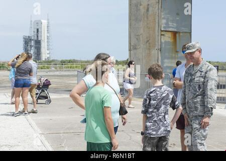 Brig. Gen. Wayne Monteith, 45th Space Wing commander, speaks with Airmen and their family members at the Apollo 1 pad during the 2017 Cape Family Day, April, 29, 2017, at Cape Canaveral Air Force Station, Fla. The tour route concluded at the Apollo 1 pad at Launch Complex 34 where visitors were able to tour the site of the tragedy, which claimed the lives of three American astronauts. - Stock Photo