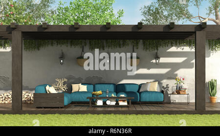 Blue sofa under a wooden pergola - Stock Photo
