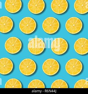 Lemon slices pattern on vibrant turquoise color background - Stock Photo
