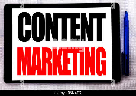 Conceptual hand writing text caption inspiration showing Content Marketing. Business concept for Online Media Plan written on tablet computer on the white background with pen in the office. - Stock Photo
