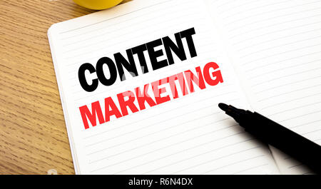 Conceptual hand writing text caption inspiration showing Content Marketing. Business concept for Online Media Plan written on notebook, copy space on book background with marker pen - Stock Photo