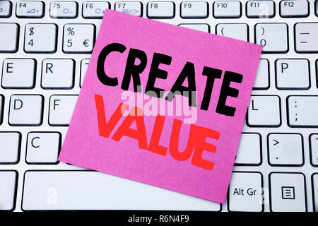Handwriting Announcement text showing Create Value. Business concept for Creating Motivation written on sticky note paper on the white keyboard background. - Stock Photo