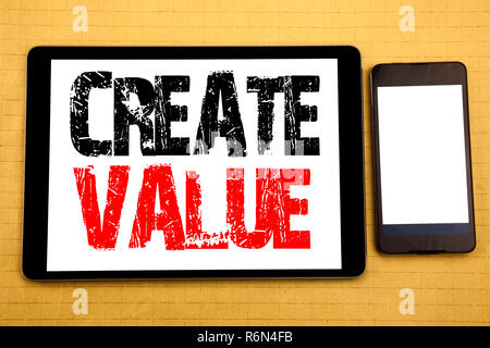 Hand writing text caption inspiration showing Create Value. Business concept for Creating Motivation Written on tablet laptop, wooden background with sticky note, coffee and pen - Stock Photo