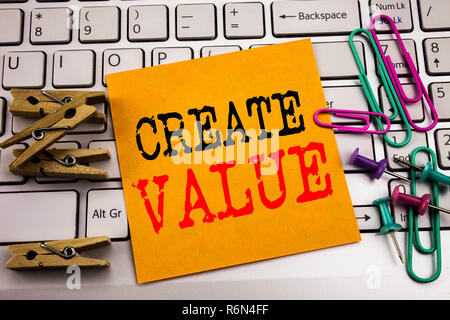 Writing text showing Create Value. Business concept for Creating Motivation written on sticky note paper on the white keyboard background. - Stock Photo