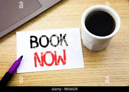 Handwriting Announcement text showing Book Now. Business concept for Reservation Buy Booking written on notebook book on the wooden background in the Office with laptop coffee - Stock Photo