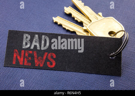 Handwritten text showing Bad News. Business concept writing for Failure Media Newspaper Written on note paper attached to the key, black background with space close up - Stock Photo