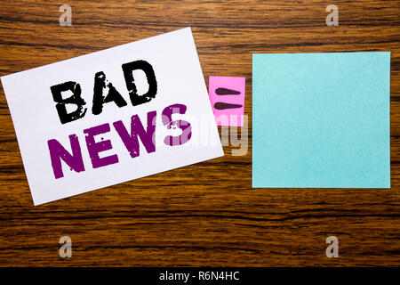 Handwriting Announcement text showing Bad News. Business concept for Failure Media Newspaper written on sticky note paper on wooden background. Equation mathematical sign for your space - Stock Photo