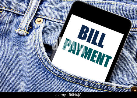 Conceptual hand writing text caption inspiration showing Bill Payment. Business concept for Billing Pay Costs Written phone mobile phone, cellphone placed in the man front jeans pocket. - Stock Photo