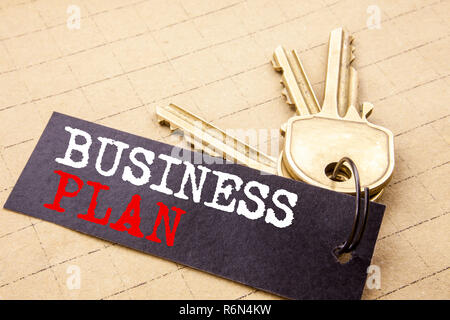 Conceptual hand writing text caption showing Business Plan. Business concept for Mission or Vision written on note paper attached to the keys note paper on the texture background. - Stock Photo