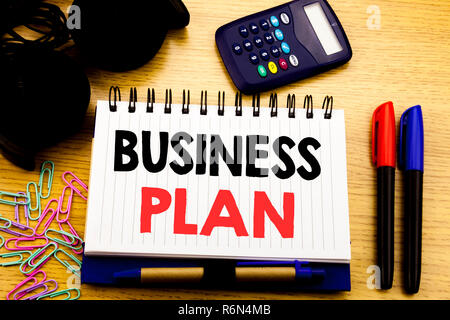 Conceptual hand writing text caption showing Business Plan. Business concept for Mission or Vision written on notebook book on the wooden background in Office with laptop coffee - Stock Photo