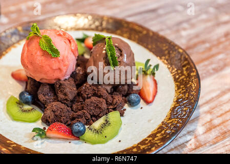 Chocolate brownie with gelato - Stock Photo