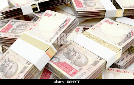 A pile of randomly scattered bundles of indian rupee banknotes on an isolated background - 3D render - Stock Photo