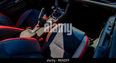 Driver and passenger seat of a car on a sunny day - Stock Photo