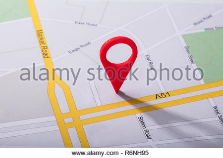 Navigation Map With Red Pin Pointer - Stock Photo