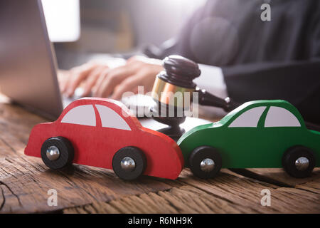 Close-up Of Two Green And Red Wooden Cars - Stock Photo