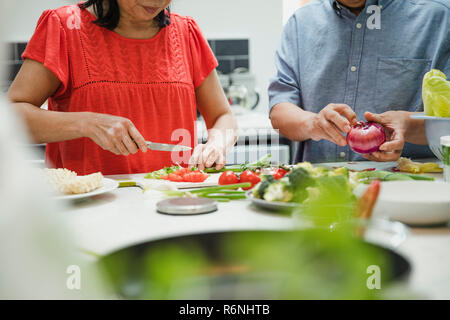 Senior Couple Making a Stir Fry Together - Stock Photo
