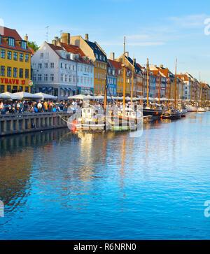 COPENHAGEN, DENMARK - JUNE 16, 2018: Tourists at Nyhavn district  - is one of the most famous landmark in Copenhagen - Stock Photo