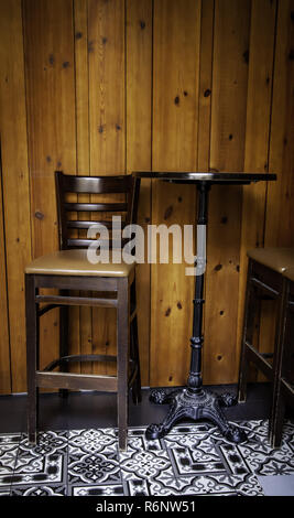 Vintage wooden stool, furniture detail to sit and rest - Stock Photo