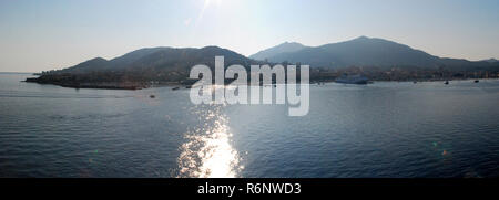 Ajaccio (Corsica, France) harbor in the sunset, view from a boat - Stock Photo