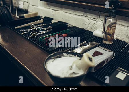 Barber shop tools on the table. Close up view shaving foam. - Stock Photo