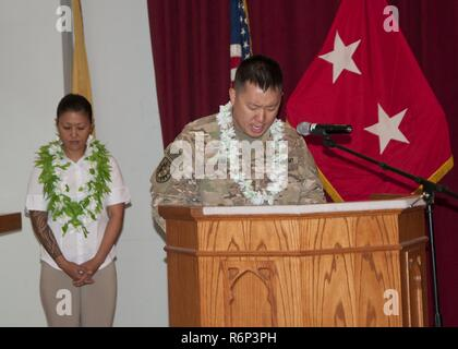 Chaplain (Maj.) James Kim, 369th Sustainment Brigade, delivers the invocation during an Asian American and Pacific Islander Heritage Month event at Camp Arifjan, Kuwait, May 31, 2017. The event highlighted the important contributions that Asian American and Pacific Islanders have made to the U.S. military. - Stock Photo