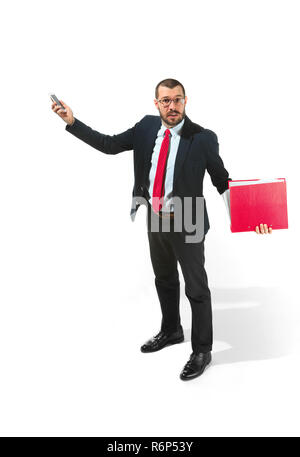 Angry businessman talking on the phone with folder in hand isolated over white background in studio shooting - Stock Photo
